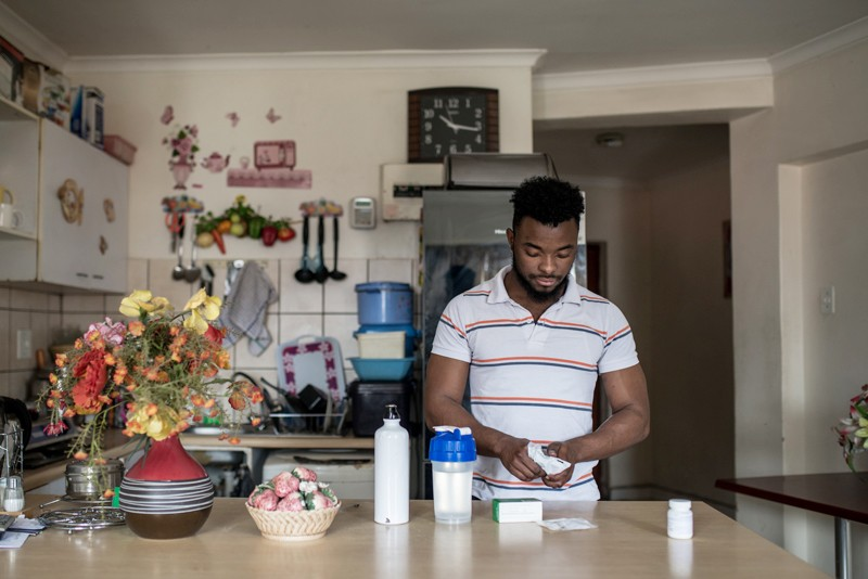 Grajevis Bakatunkanda, who has sickle cell anaemia, takes his medication in his family home in Wynberg, Cape Town, South Africa.