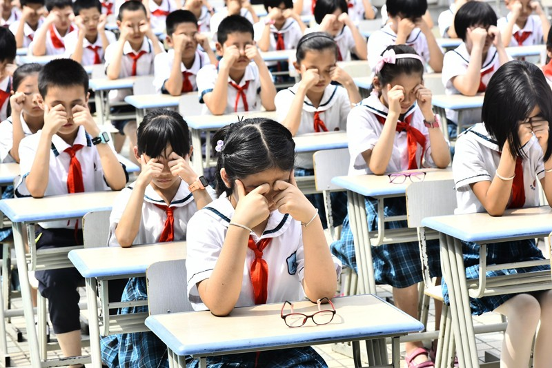 Students do eye exercises at Huangshanlu Primary School in Hefei, east China's Anhui Province