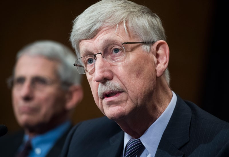 Dr. Francis Collins, right, director of the National Institutes of Health.