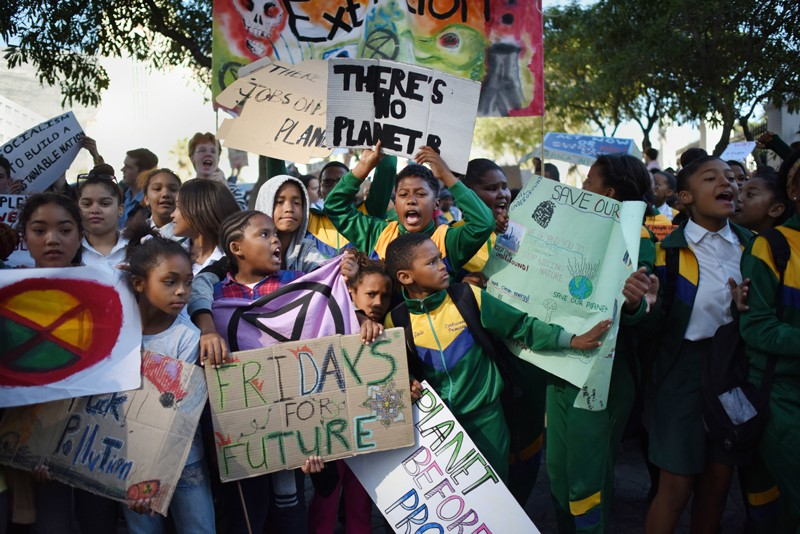 School children at a demonstration outside the South African Parliament calling for action on climate change