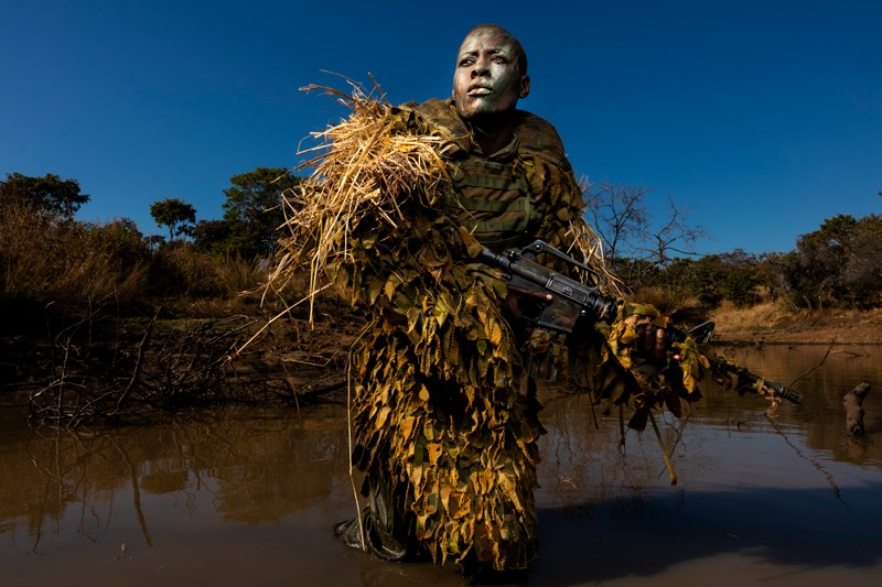 Petronella Chigumbura, a member of the Akashinga, practices reconnaissance techniques in the Zimbabwean bush