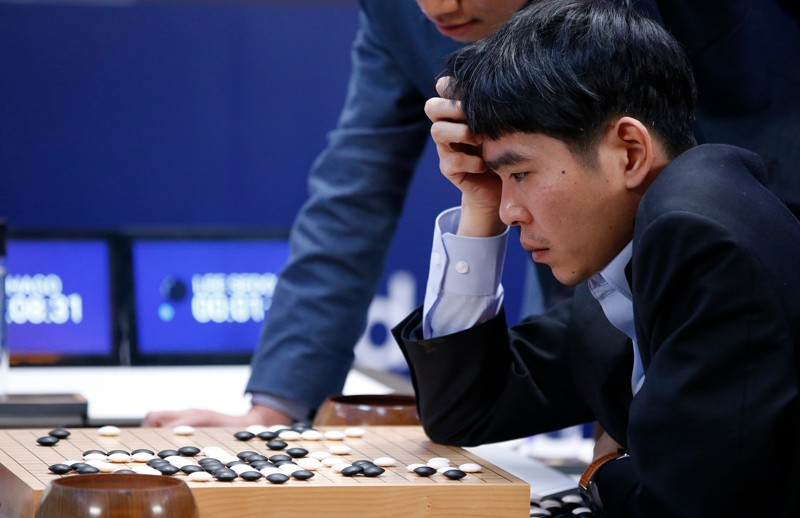 South Korean professional Go player Lee Sedol reviews a match against against Google's artificial intelligence program, AlphaGo