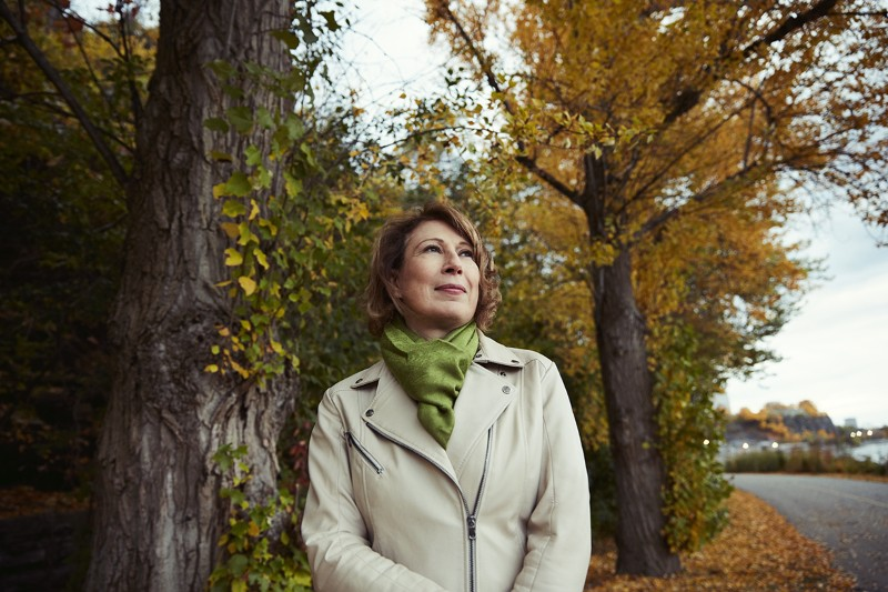Mona Nemer walks on the path along the Ottawa River