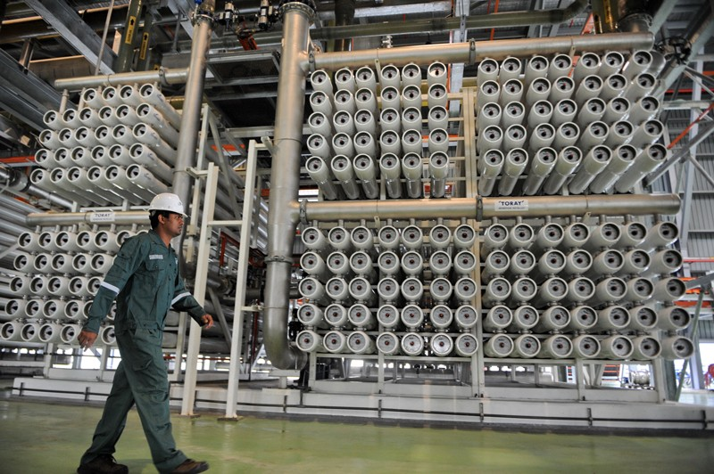 An engineer makes a routine check of the NEWater membrane process water treatment plant in Singapore