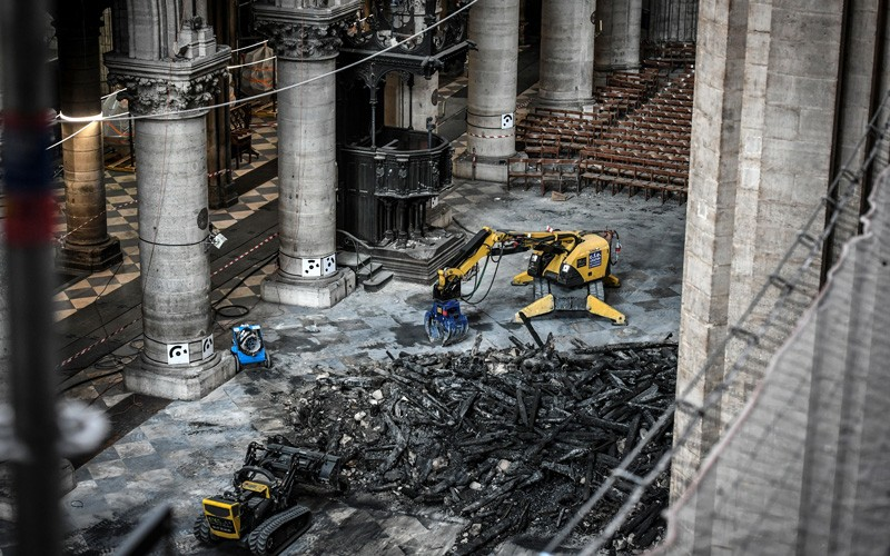 Excavators are seen during preliminary work in the Notre-Dame de Paris Cathedral.
