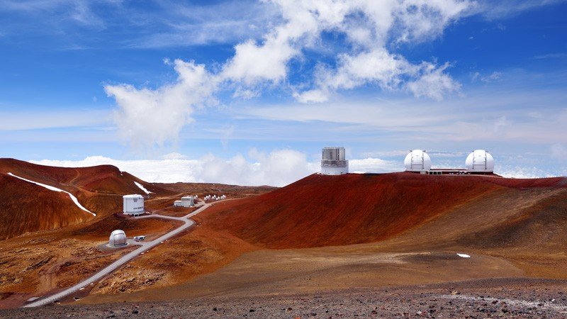 Observatories on top of Mauna Kea mountain peak.