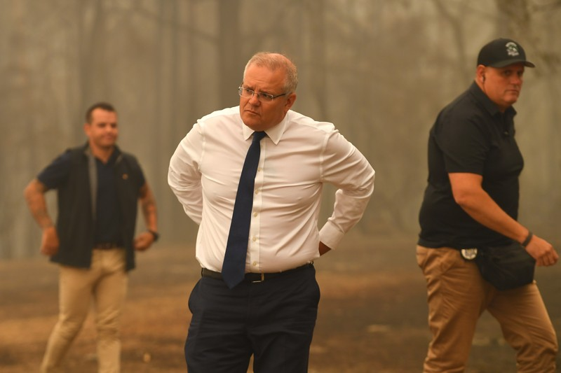 Australian Prime Minister Scott Morrison observes the damage caused by bushfires in Sarsfield, Victoria, Australia
