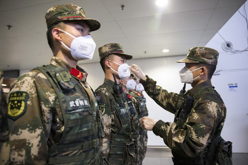 Chinese paramilitary policemen wearing face masks for prevention of the new coronavirus