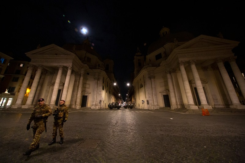 Rome's Via del Corso from Piazza del Popolo with some soldiers in the evening