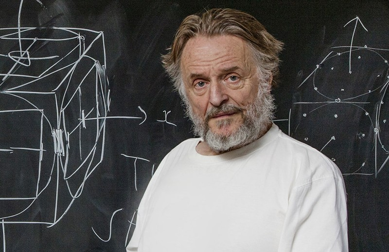 John Horton Conway standing in front of a blackboard with diagrams