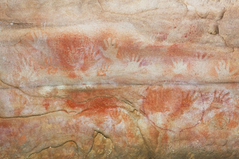 : Red Hands Aboriginal cave painting in the Blue Mountains National Park, Sydney, NSW, Australia
