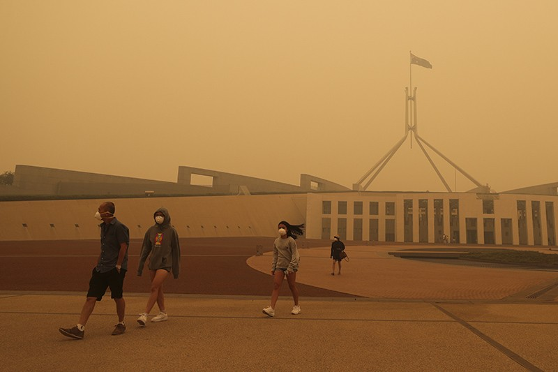 Visitors to Parliament House wear face masks after smoke from bushfires blankets Canberra, Australia.