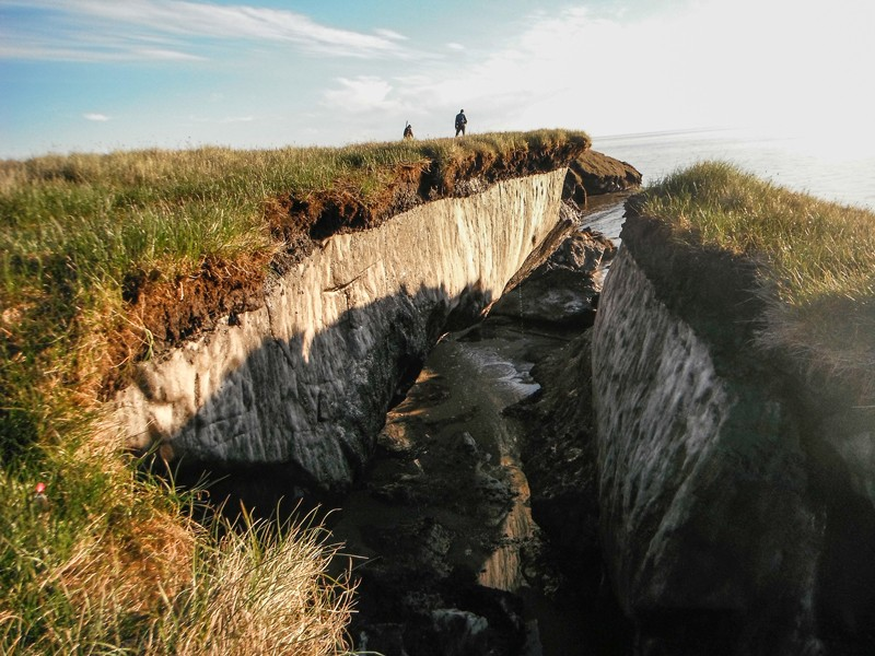 A crevasse in Alaska reveals ice-rich permafrost that has been exposed by coastal erosion