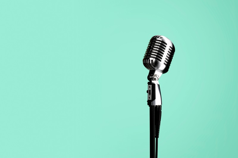 Freestanding microphone on green background