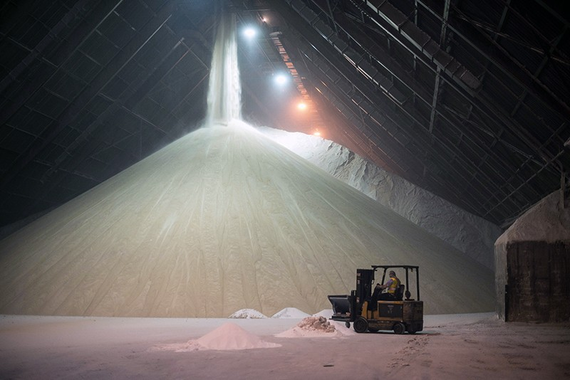 Raw sugar is offloaded from a cargo ship into a refinery and storage facility in Toronto, Ontario, Canada.