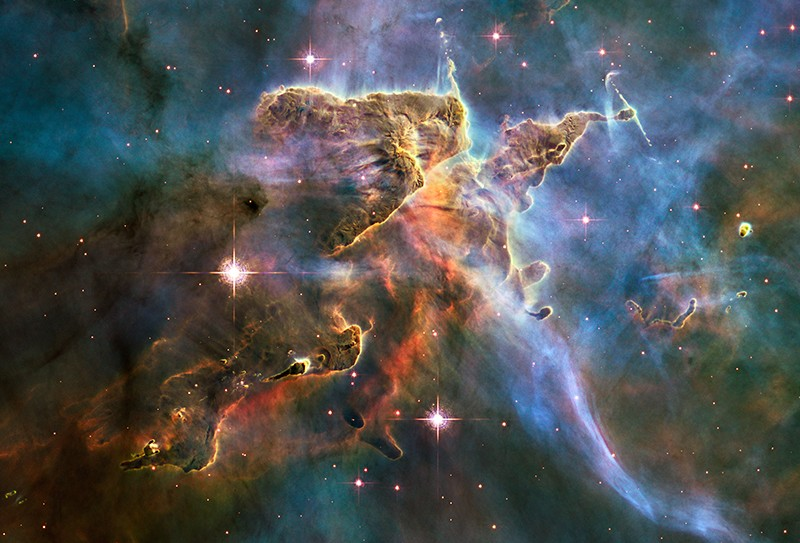 Cold interstellar gas and dust rising from near the Carina Nebula