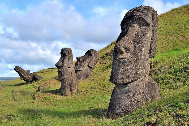 Four Moais, the typical large monolithic human figures statues, on Easter Island