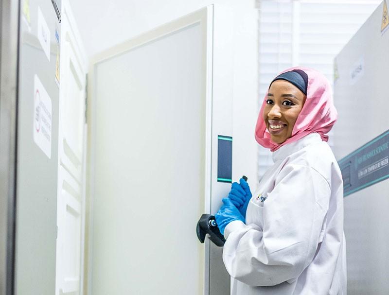 Zara Modibbo, VP Lab Operations for 54gene, opening the biobank