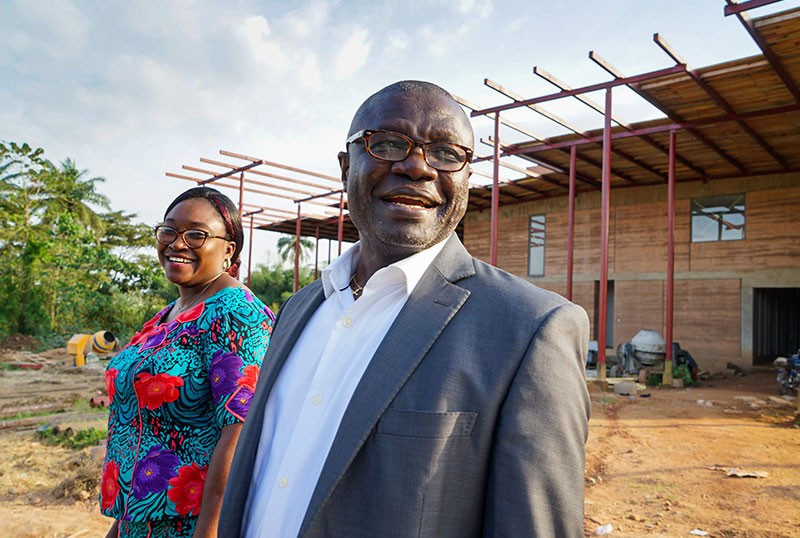 Christian Happi with aChristian Happi outside The African Centre of Excellence for Genomics of Infectious Diseases