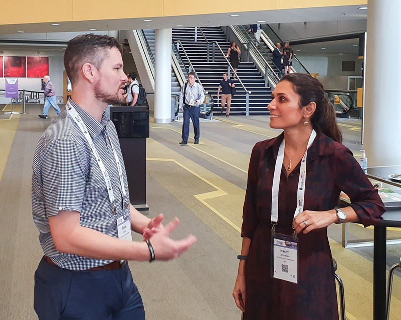 Drew Evans chatting to early career researcher Nasim Amiralian