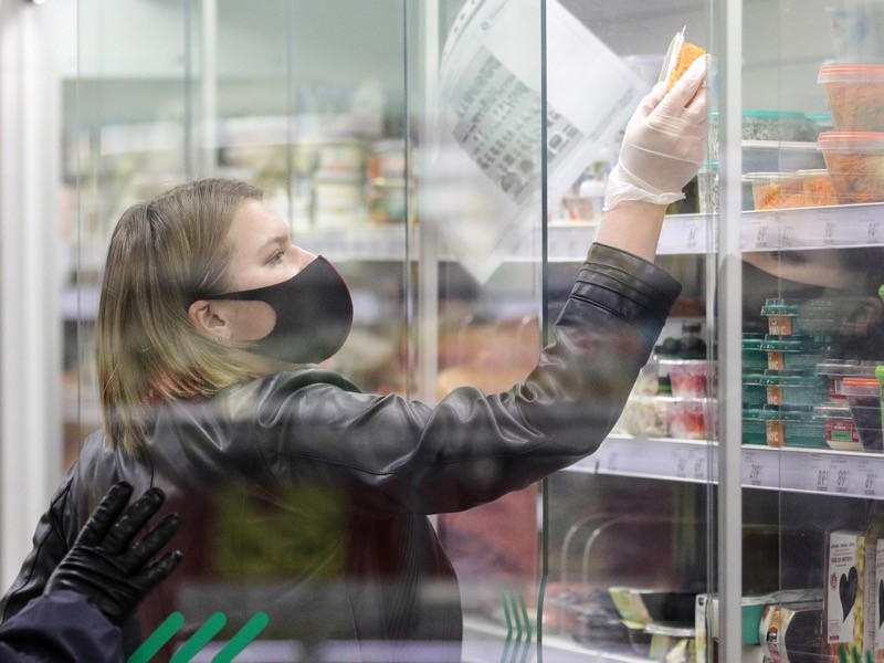 A customer shopping for groceries at a Pyaterochka supermarket in Moscow's Severnoye Tushino District.
