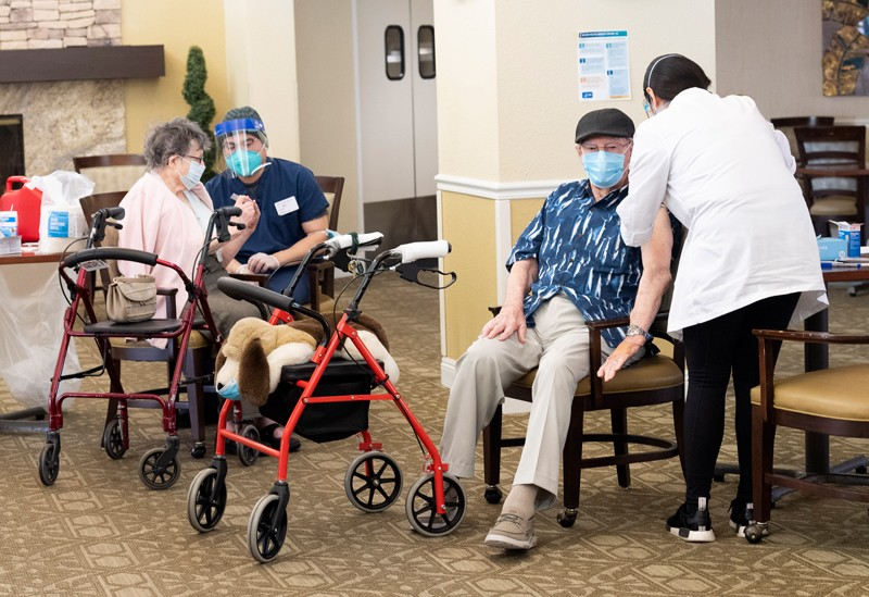 Residents get the COVID-19 vaccine at the Emerald Court senior living community in Anaheim