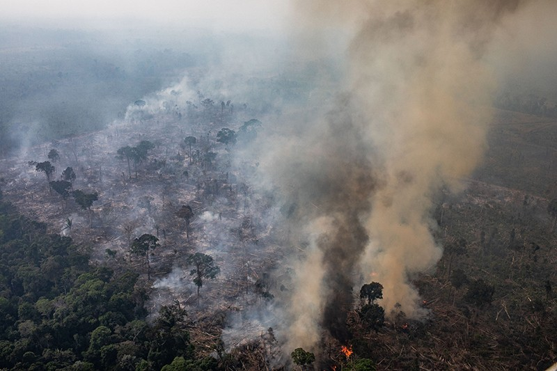 An aerial view of a fire burning in a section of the Amazon rain forest in Brazil.
