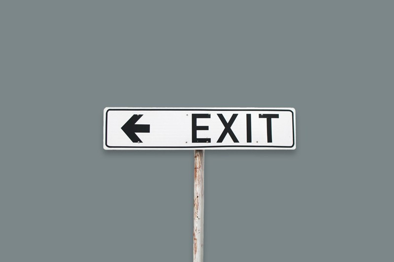 Exit sign on a dark grey background