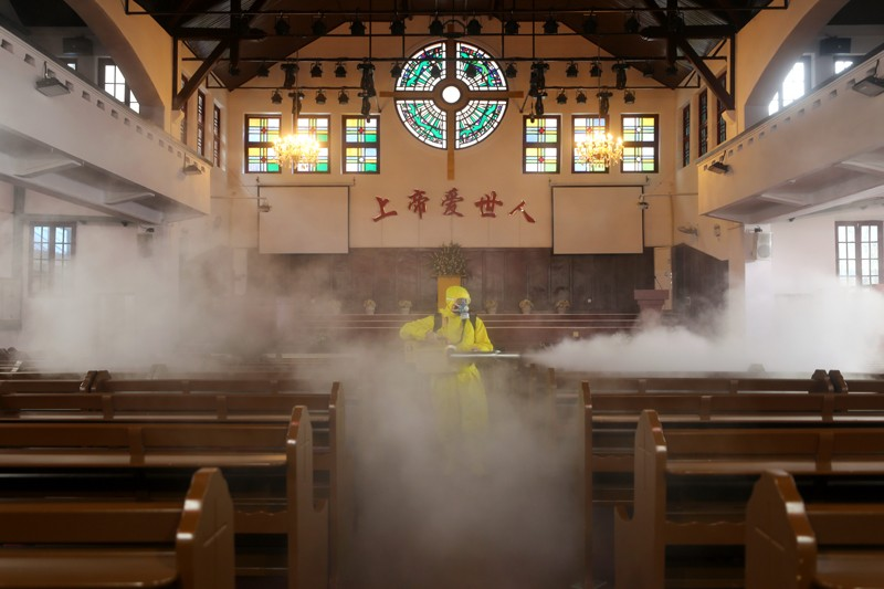 A volunteer disinfects a Christian church in Wuhan