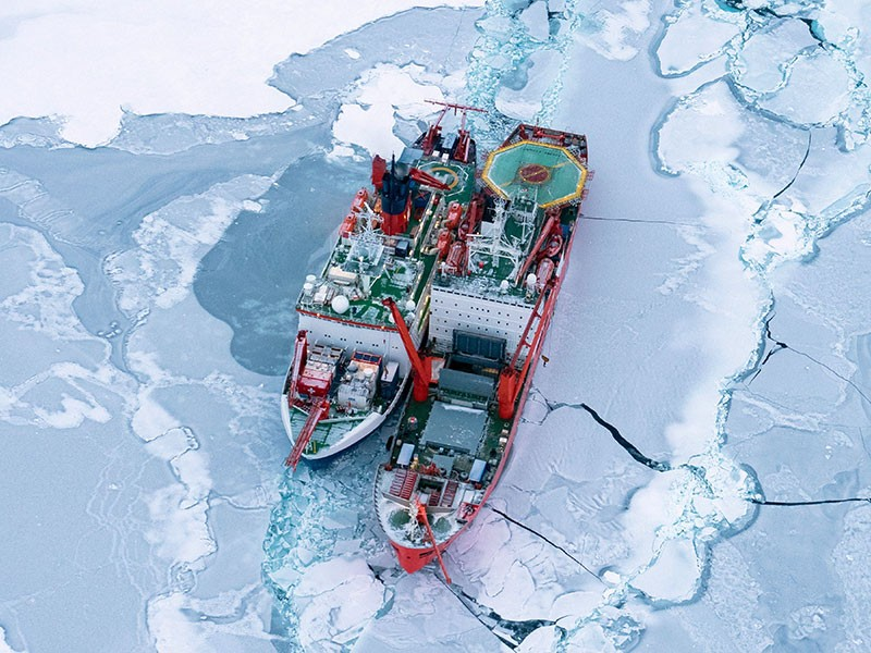 Aerial view of RV Polarstern alongside Akademik Fedorov during cargo operations