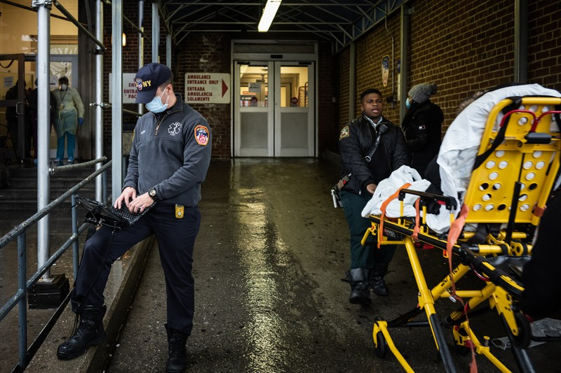 EMS personnel work outside the Emergency Department at St. Barnabas Hospital, NYC