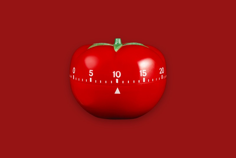 Tomato timer on a red background