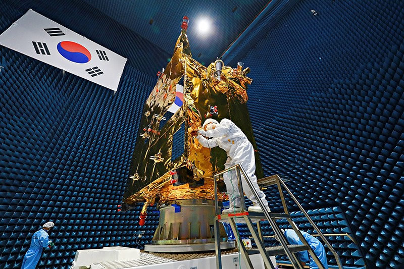 A worker in porotective clothes checks the Cheollian 2B satellite