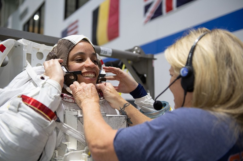 NASA astronaut Jessica Watkins is helped into a spacesuit