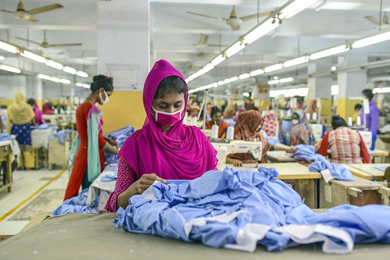 Garment factory workers wear face masks during the lockdown in Bangladesh.