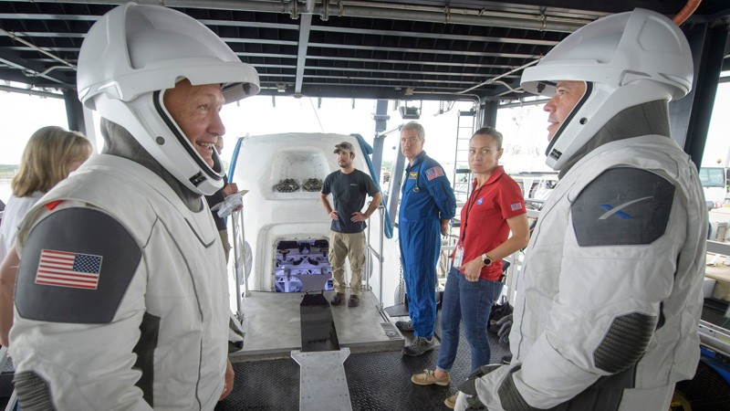 NASA astronauts Doug Hurley, left, and Bob Behnken work with teams from NASA and SpaceX to rehearse crew extraction.