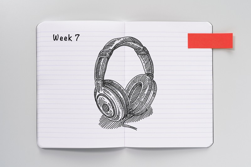 Open notebook with a sketch of headphones