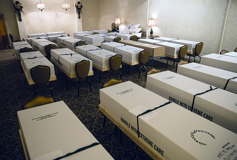 Cremation boxes, mostly containing the bodies of suspected covid-19 patients, at a funeral home in the Queens , New York, USA.
