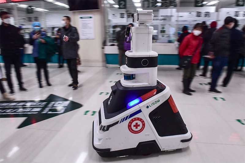 Photo of a patrol robot moving across the floor at a hospital in Shenyang, China