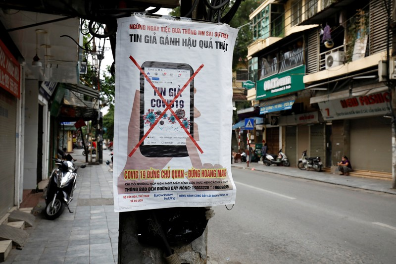 A poster warning against the spread of 'fake news' online
