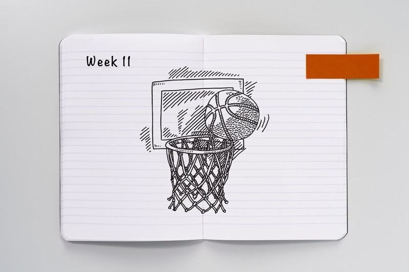 Open notebook with a sketch of a basketball and hoop
