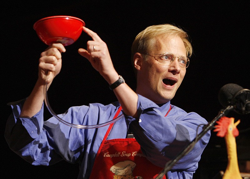 "Brian Wansink of Cornell University demonstrates his ""bottomless bowl of soup"" on stage in 2007."