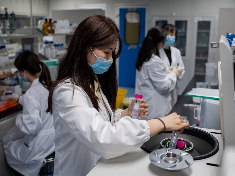 Engineers work on an experimental vaccine for the COVID-19 coronavirus at the Quality Control Lab at the Sinovac, Beijing.