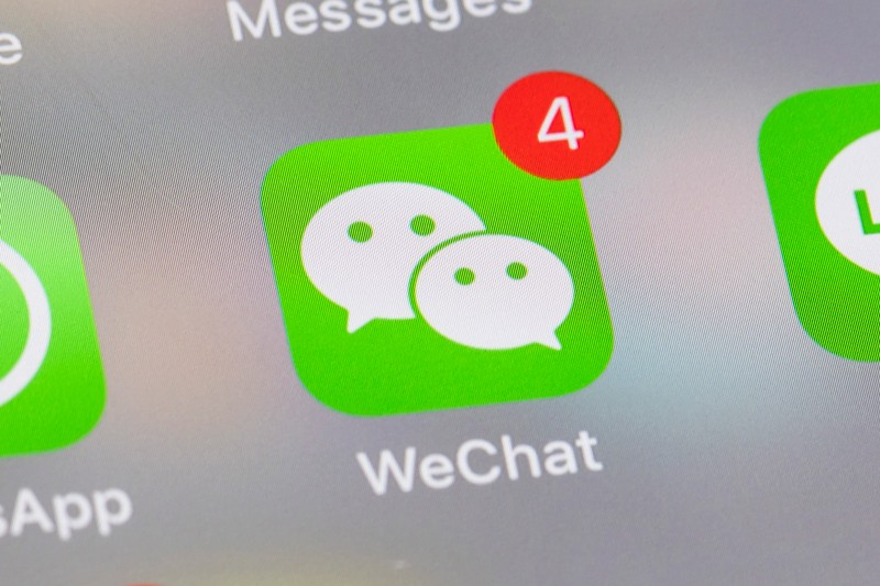 A smart phone with the icon for the social networking app WeChat