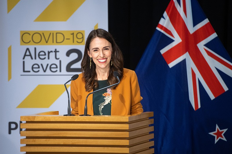 New Zealand's prime minister, Jacinda Adern, onstage at a news conference.