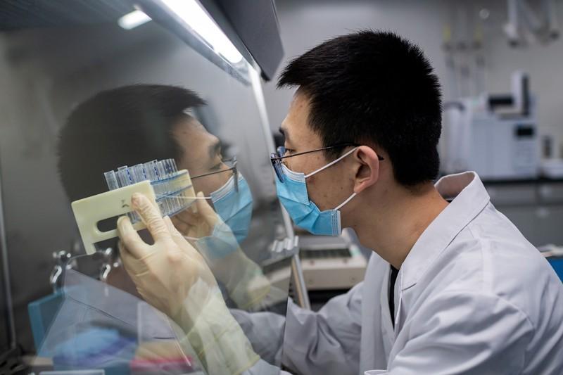 An engineer working on an experimental vaccine for the COVID-19 coronavirus