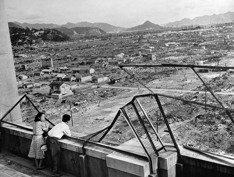Photo dated 1948 shows a man and a woman looking over the devastated city of Hiroshima after the 1945 nuclear bombing