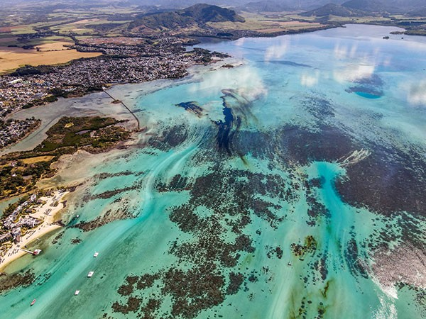 An aerial view of the MV Wakashio off the coast of south-east Mauritius and a large patch of leaked oil.