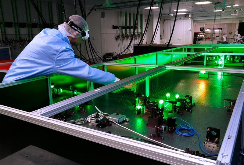 A green laser being tested by a technician at the ELI-NP facility