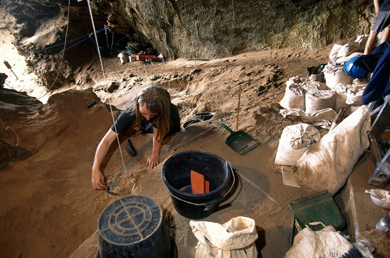 An archeological dig in a cave.